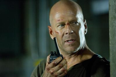 "Leave it to John McClane to say a big old ""Fuck You"" to text messaging, and stick straight to walkie-talkies. Oh. He has to use them because the plot needs him to so he doesn't get tracked by the villains? Well, it's still old-school!"
