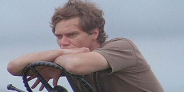 Michael Shannon pulling off the thinking man.