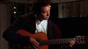 A mariachi and his guitar. Aka, LOSER.