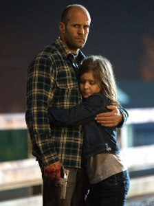 Even with the gun in his hand, The Stath's still got time for his daughter.