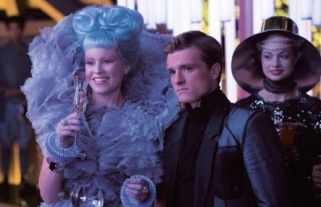 Smile a bit. Peeta! You're next to Elizabeth Banks! Lord knows I'd be!