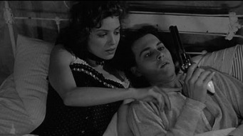 That actress laying next to Johnny is Mili Avital; she is nine years younger than he is. As we all know, he's way past that age-difference.