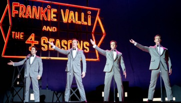 There's four up there, but Franki Valli has already been accounted for. So who the hell is the fourth person? The drummer?