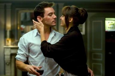 Of course he has a smokin' hot, European girlfriend! It's Johnathan Rhys Meyers!